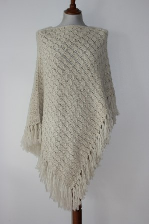 loose knit crochet style sumptious soft cashmere with long tassels, reversible offset poncho...trans seasonal piece