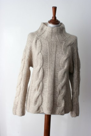loose hand knitted cable sweater, incredibly soft.  larger size available. think apres ski, sunday afternoon walk sweater....