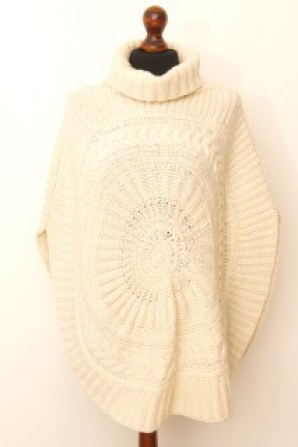 densely knitted circular cable knit poncho with roll neck